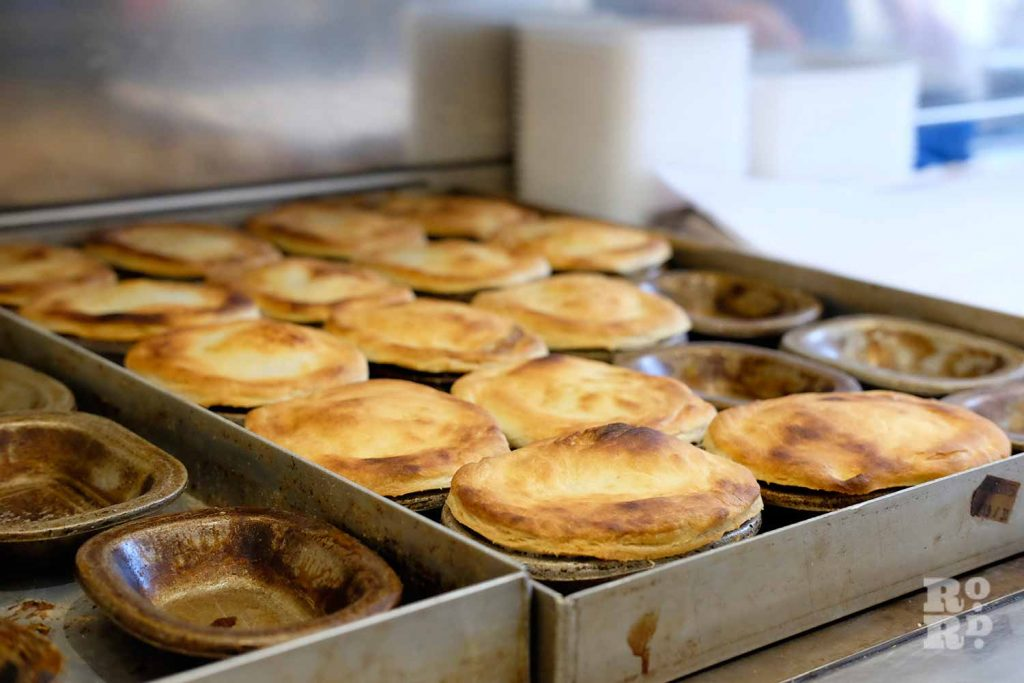 G.Kelly pie and mash Roman Road pies lined up in dishes
