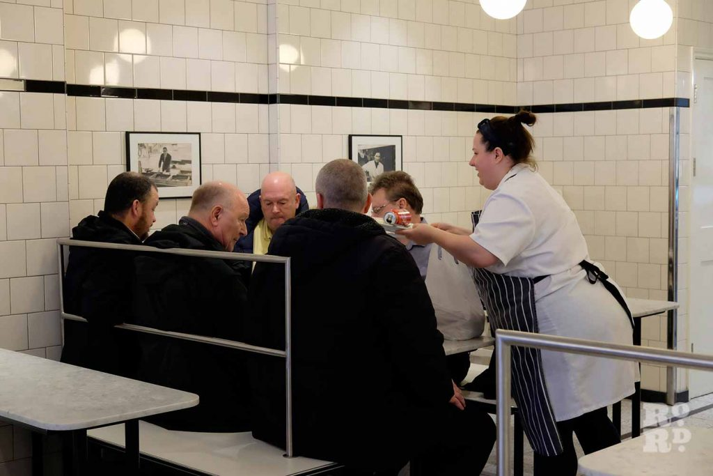 G.Kelly pie and mash Roman Road waiting on group of men