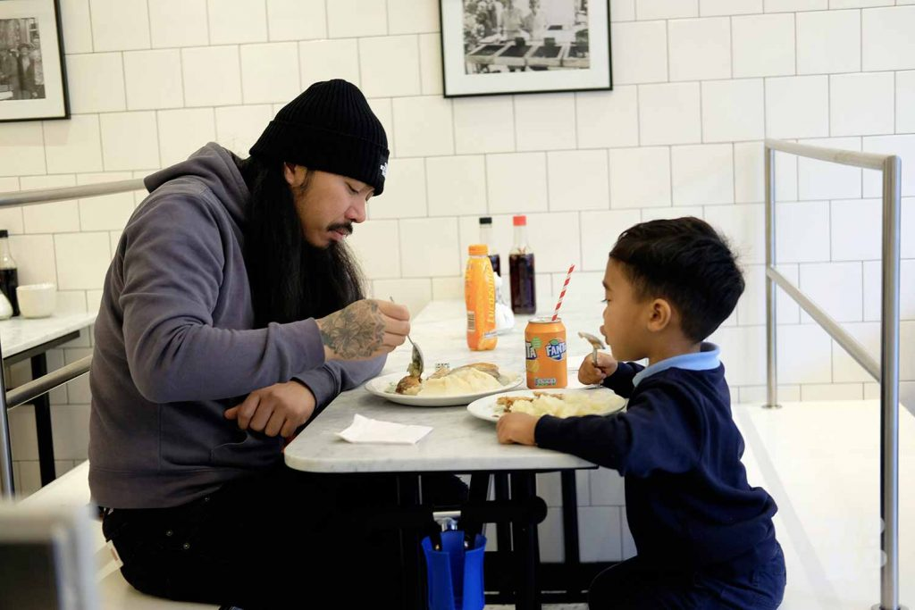 G.Kelly pie and mash Roman Road dad and child enjoying meal