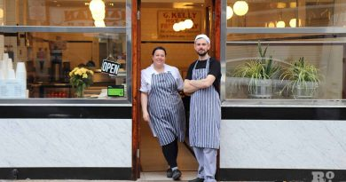 G.Kelly pie and mash Roman Road staff outside shopfront