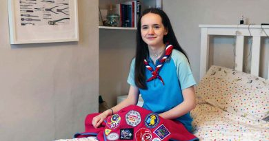 Girl Guide Maud McLaughlin with her camp blanket in bedroom