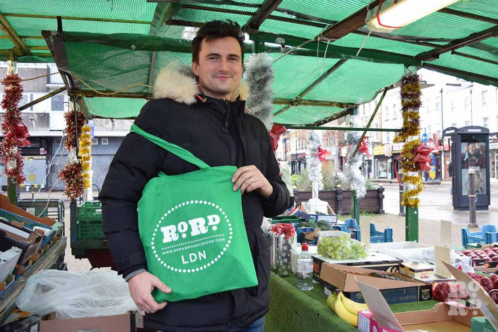 Market stall holder Marc Herbert with the Roman Road LDN shopping tote bag in green