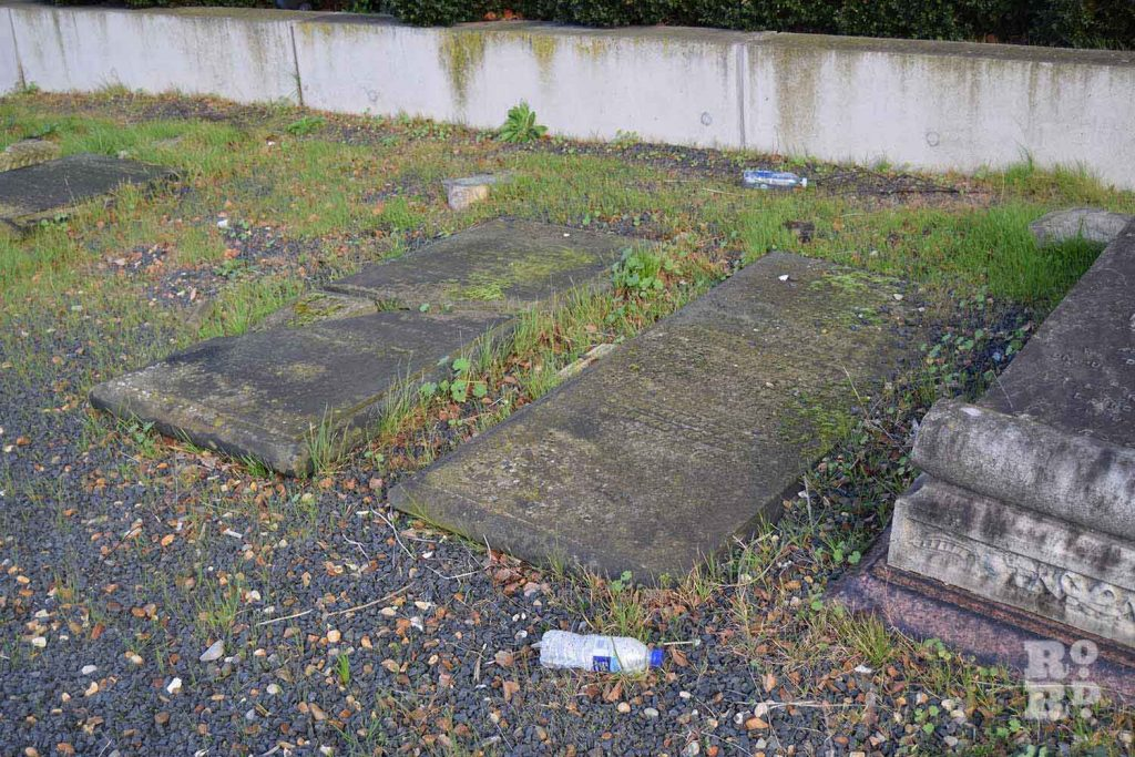 A plastic water bottle littered by gravestone at Novo Jewish Cemetery, Mile End, London.