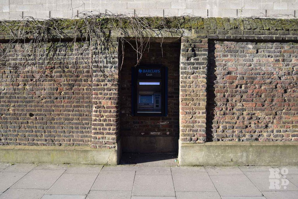 Barclays ATM at Mile End Road and the previous entrance of Novo Jewish Cemetery, Mile End, London.