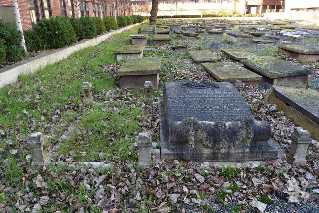 Horizontal Gravestones in the grass at Novo Jewish Cemetery, Mile End, London.