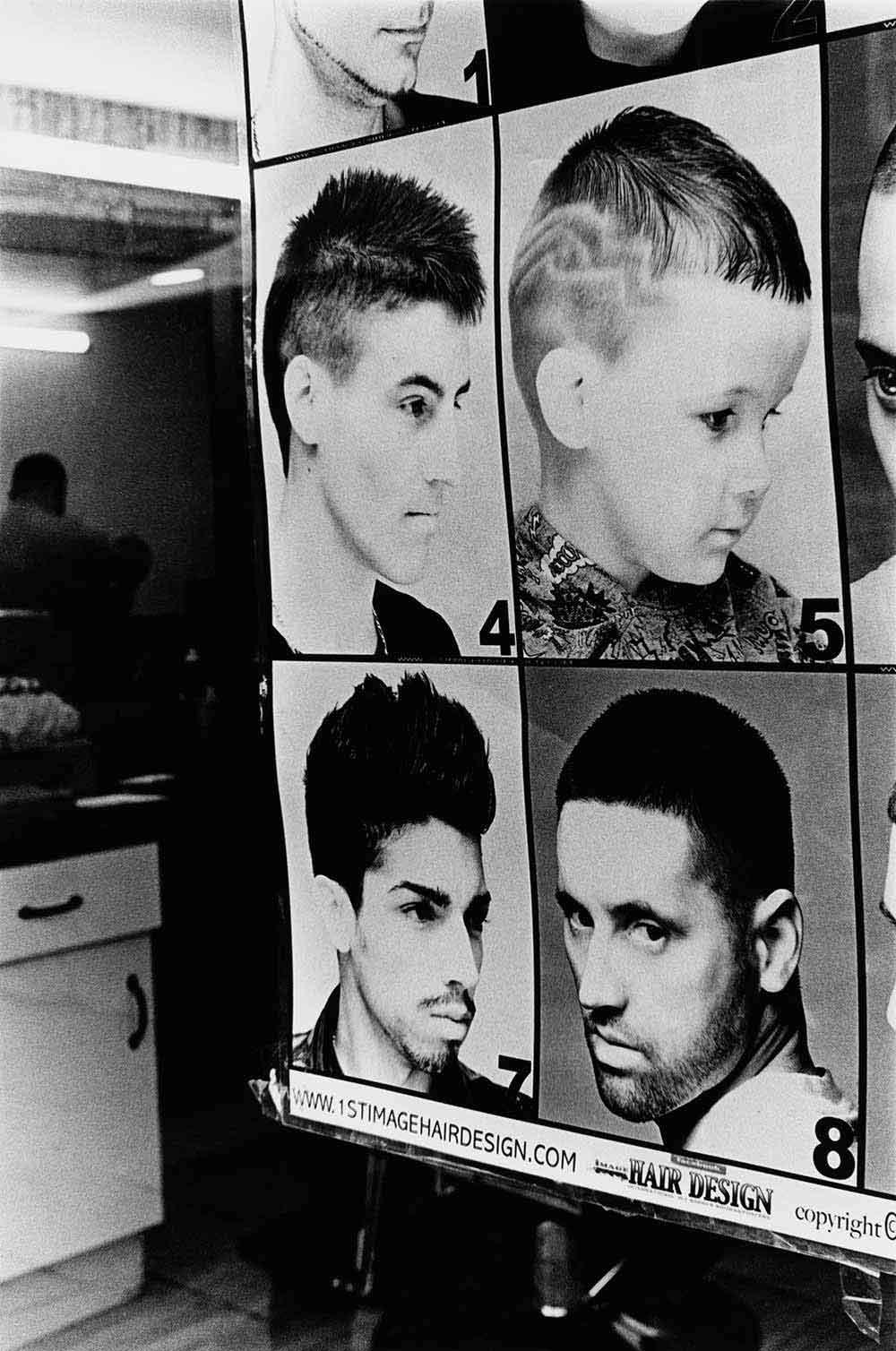 Barber shop, part of a series of photographs by Stephie Devred that captures the unique spirit of the East London street market, Roman Road Market.