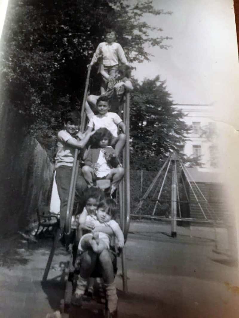 Children on a slide in in 1970 in Tredegar Square, Mile End, East London