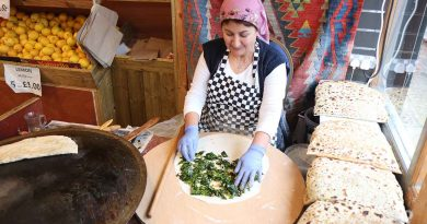 Turkish woman making gozleme pancakes at Akdeniz store on Roman Road, East London