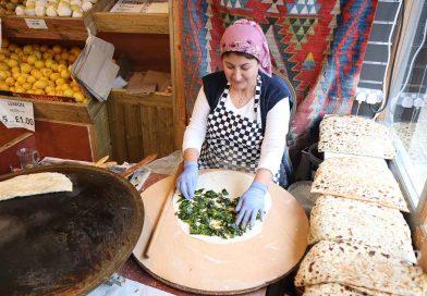 Turkish woman making gozleme pancakes at Akdeniz store on Roman Road, East London
