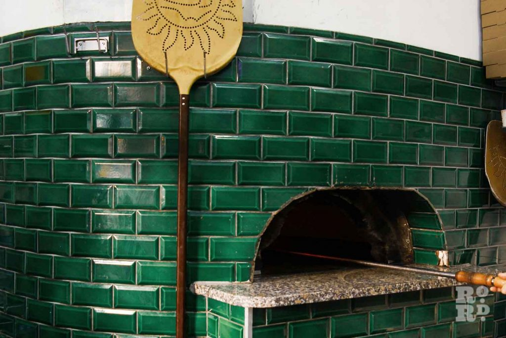 Green tiled pizza oven The Pizza Room, Mile End, East London