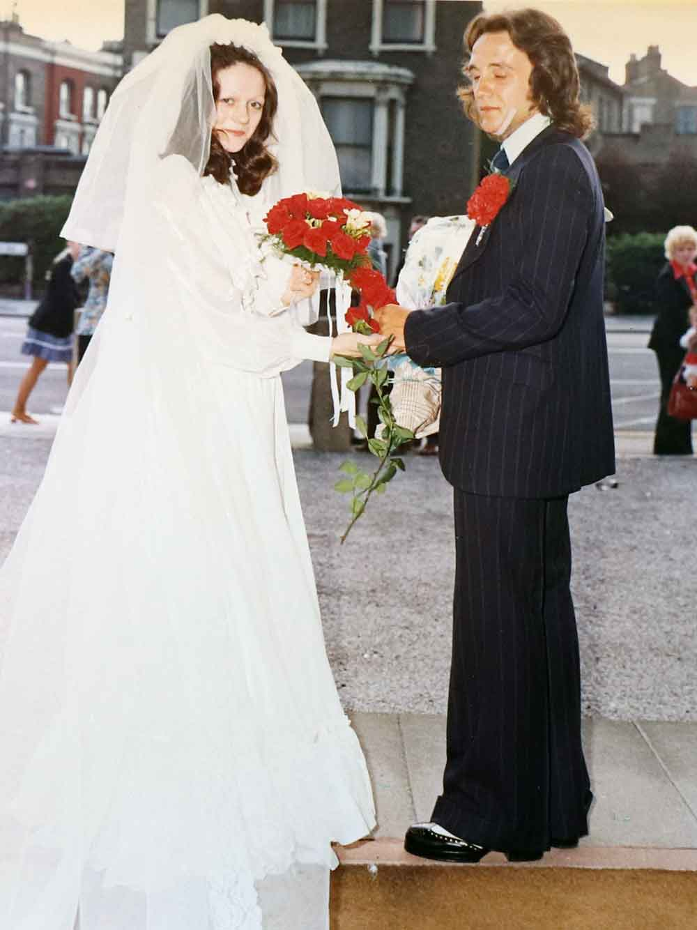 Bride with groom outside St Pauls Bow Common church, 1974