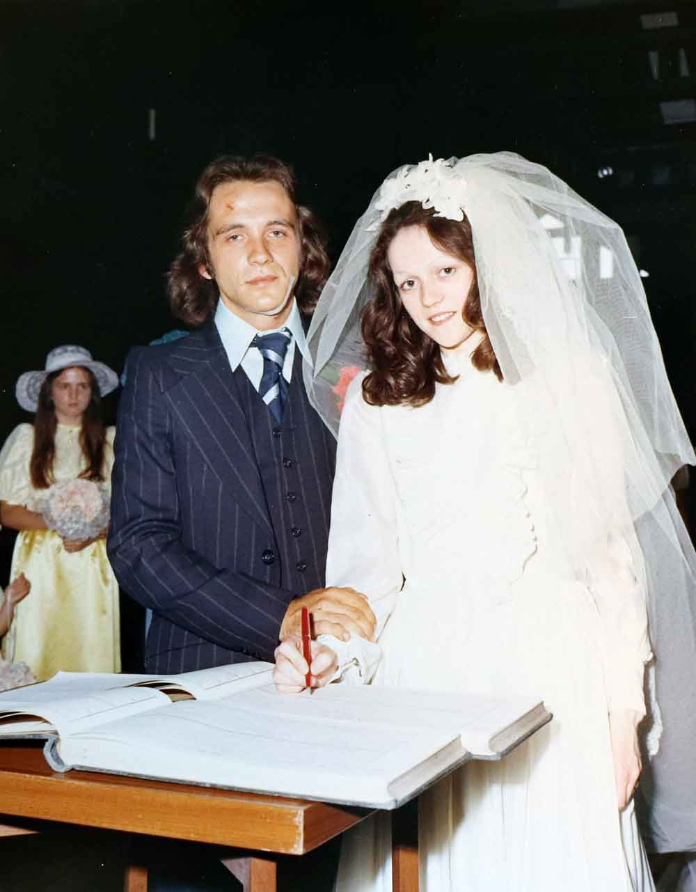Bride and groom signing register, St Pauls Bow Common 1974.
