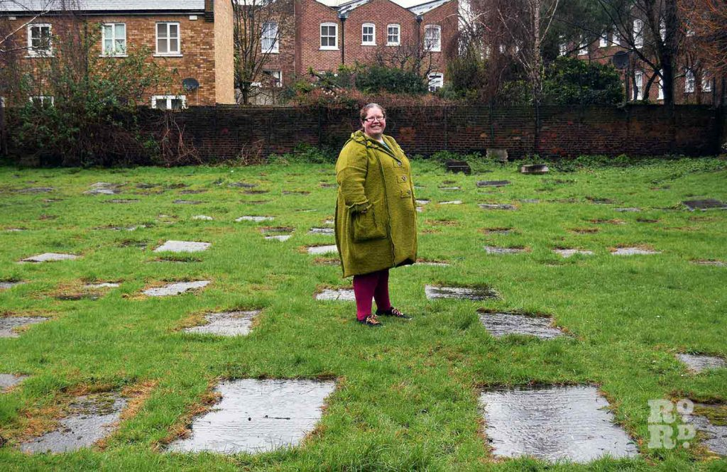 Imogen Rush standing in the gravehard at Velho Cemetery, Mile End, East London