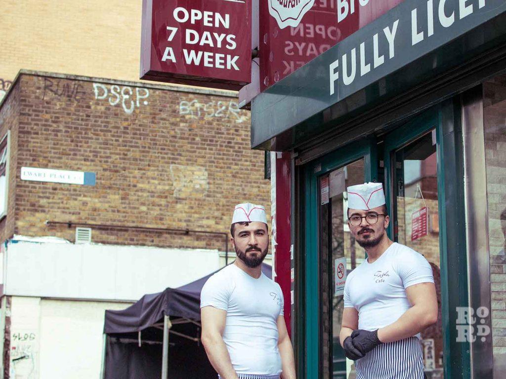 Ibrahim and Mehmet Dag standing outside Fiesta Cafe on Roman Road