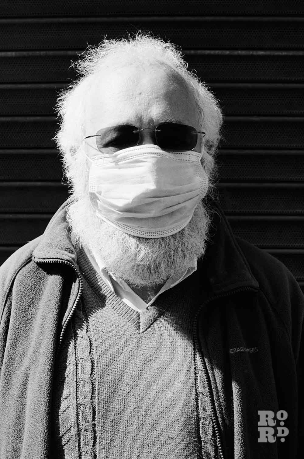 Man with large beard wears face mask during covid-19 pandemic