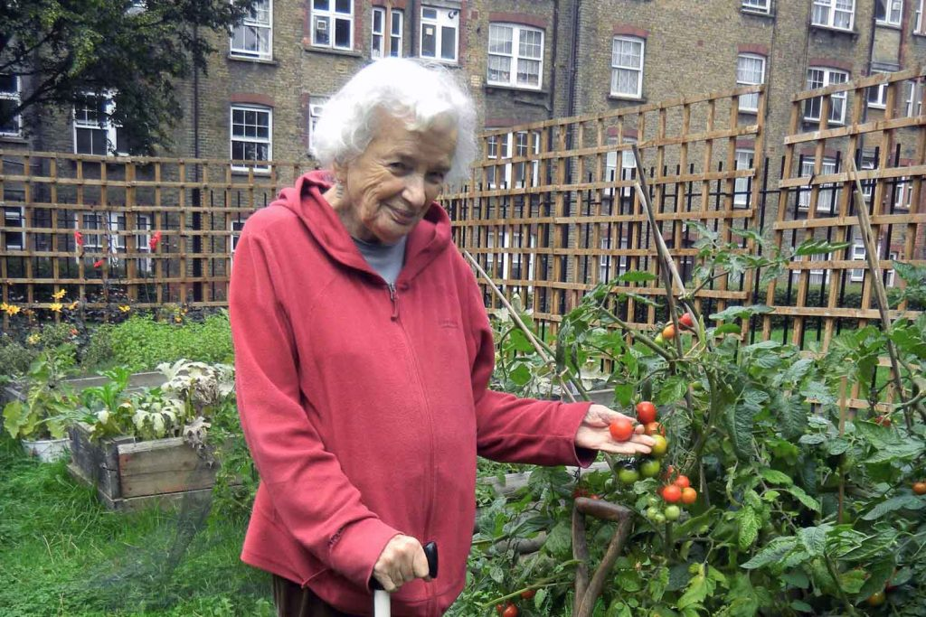 Susie Powlesland standing in the community garden she founded on the Victoria Park Estate