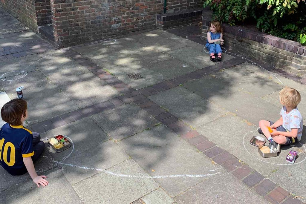Children playing on the streets in a social distanced way