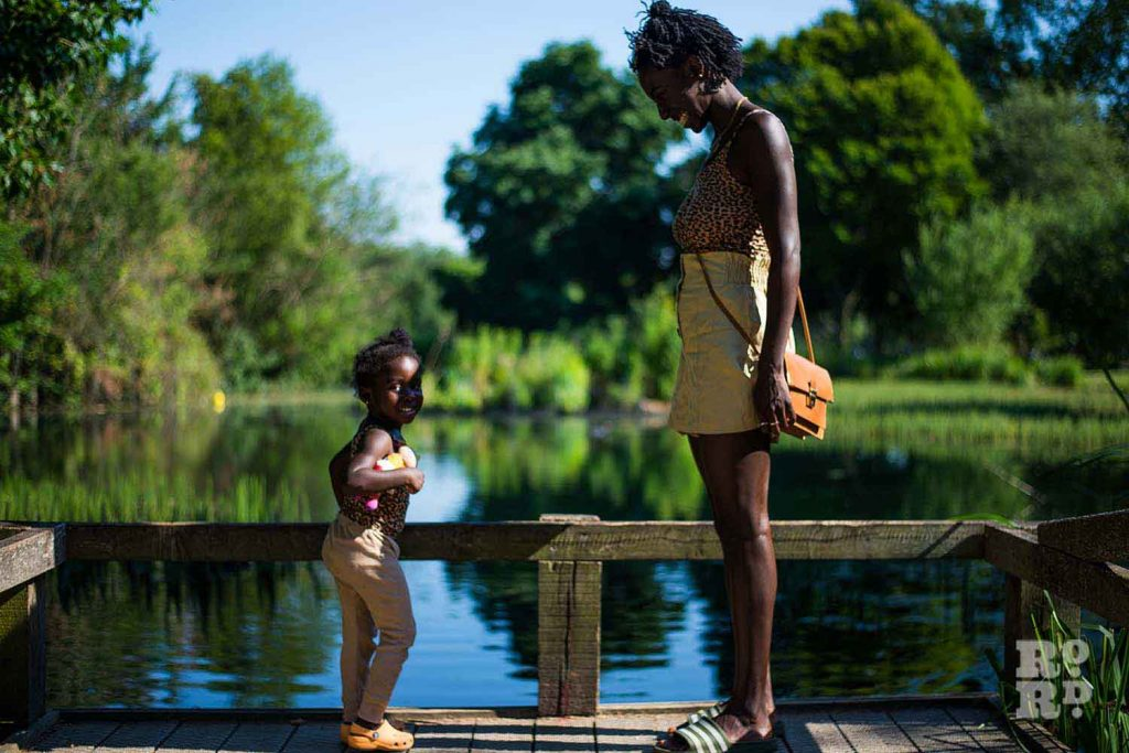 Instagram influencer Chaneen Saliee with her daughters by the lake in Victoria Park, talking about breastfeeding and being a role model for black women