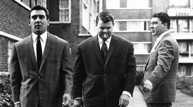 Kray Twins with Squibb walking outside flats in East London