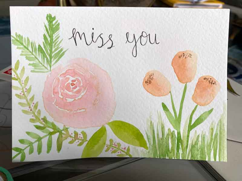 A watercolour card saying Miss You