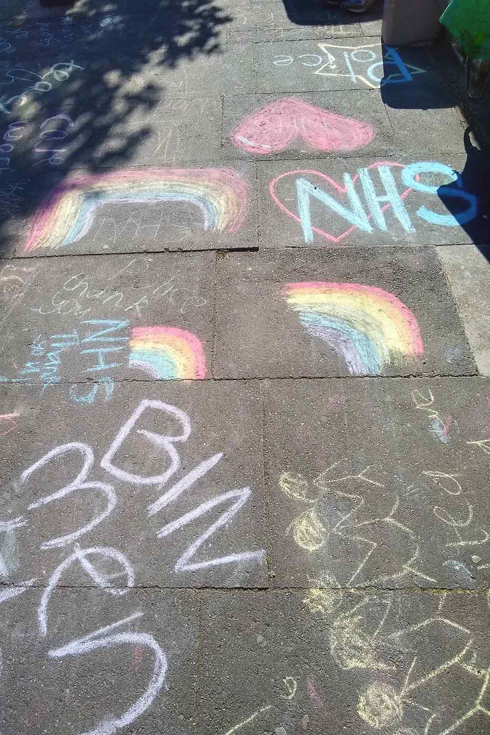 Children's chalk drawings on pavement during lockdown