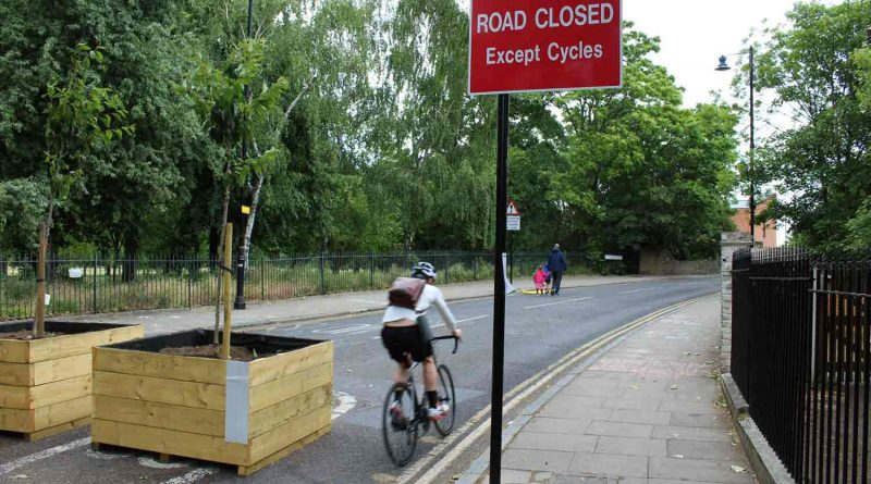 Cyclist approaching Skew Bridge on Old Ford Road, closed to traffic with planters