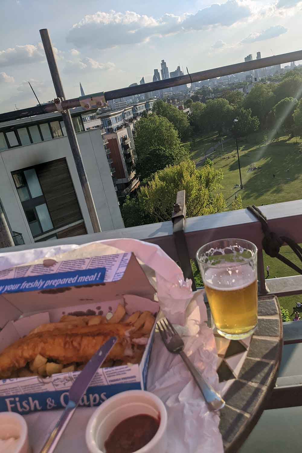 Enjoying takeway fish and chips and a pint during lockdown, 2020.