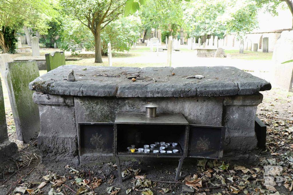 Candles lit for Baal Shem of London's grave at Alderney Cemetery, Mile End