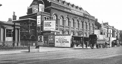 Black and White image of Bow Station in the 1920s with a horse and carriage in the foreground