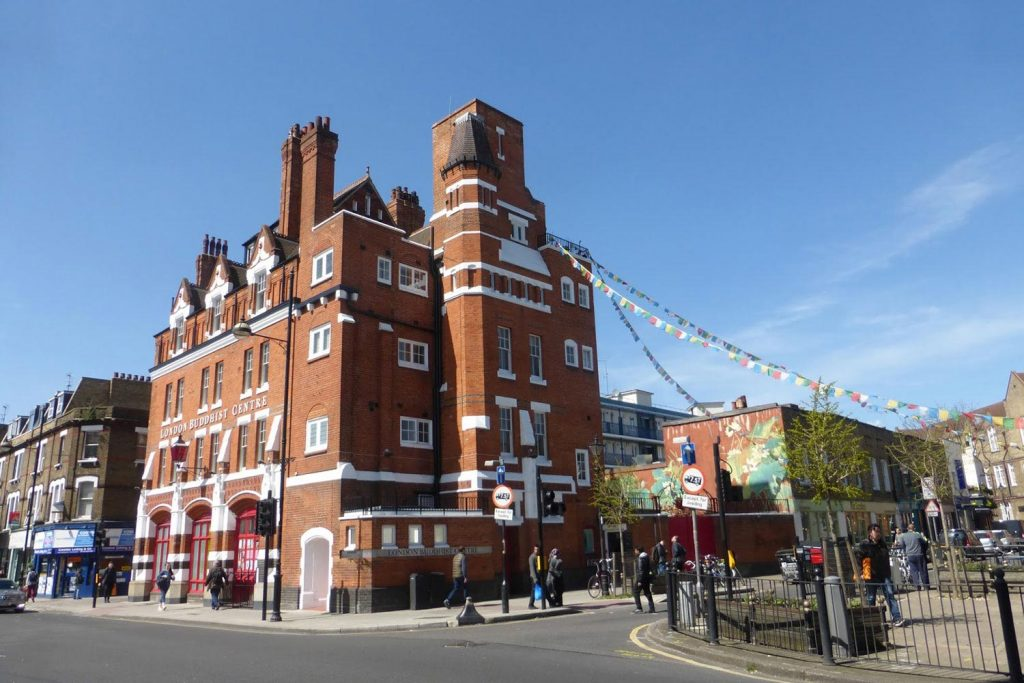Exterior of the London Buddhist Centre with blue skies