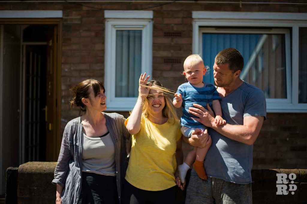 Gemma and family in their family home in Mile End laughing environmental portraits by Matt Payne