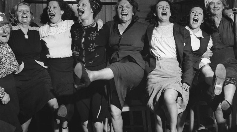 Women dancing in the pub in Knees Up Mother Brown style