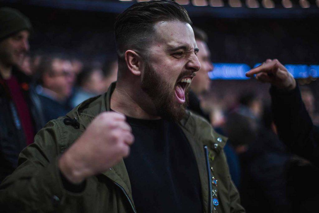 Hammers fan celebrating goal, Faces of West Ham, photos by José da Luz