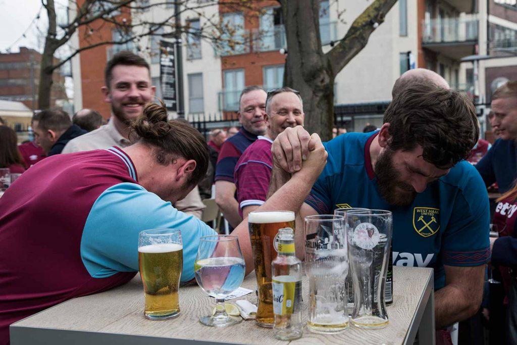 Hammers fans arm wrestling, Faces of West Ham, photos by José da Luz