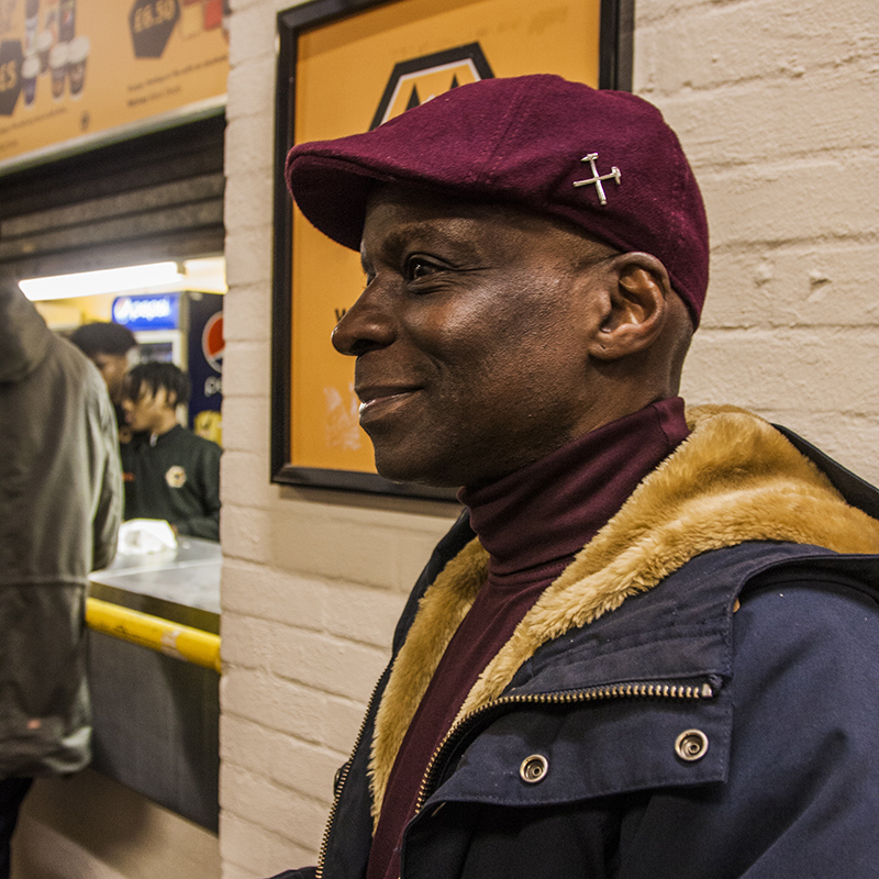 Man wearing flat cap in Hammers colour featuring crossed hammers, Faces of West Ham, photos by José da Luz