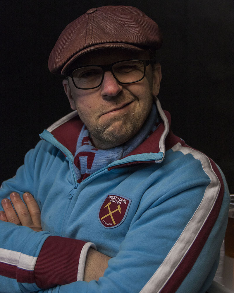 Hammers fan wearing flat cap, Faces of West Ham, photos by José da Luz