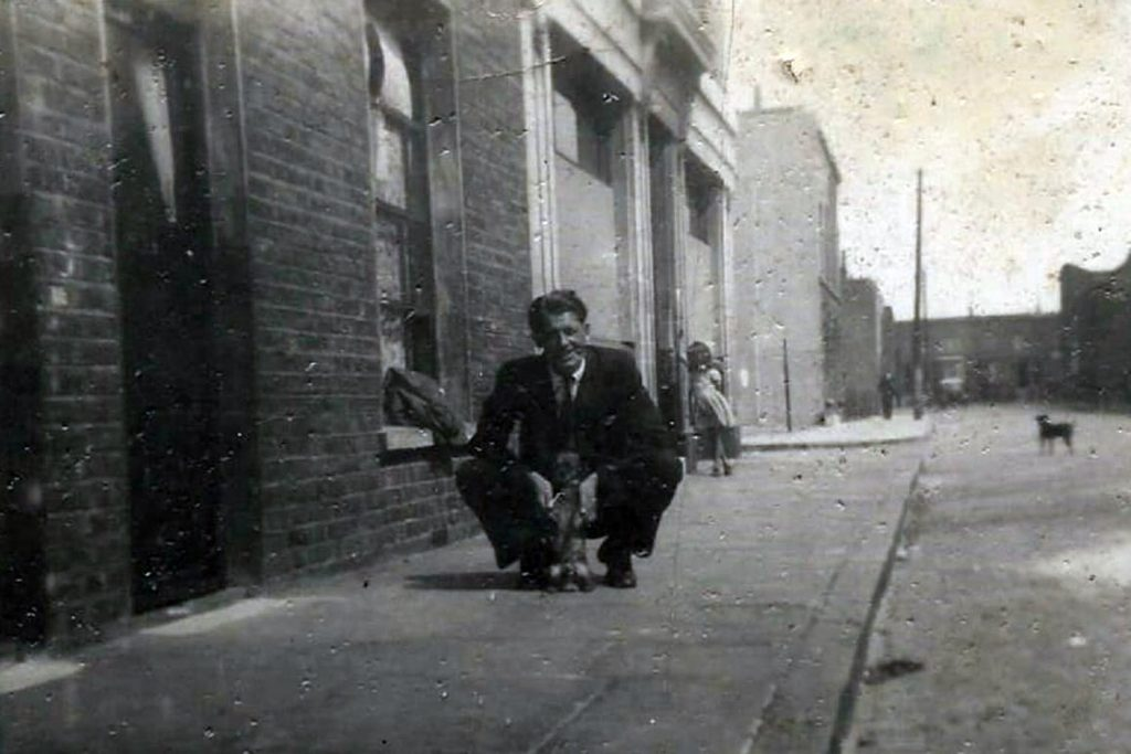 Man and his dog, outside the Palm Tree pub in the 1950s