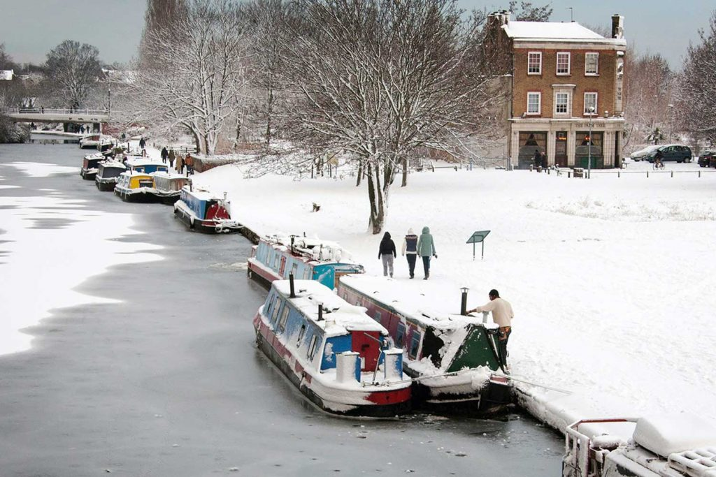 Snow by the canal and over the palm tree pub by Bob Dawson