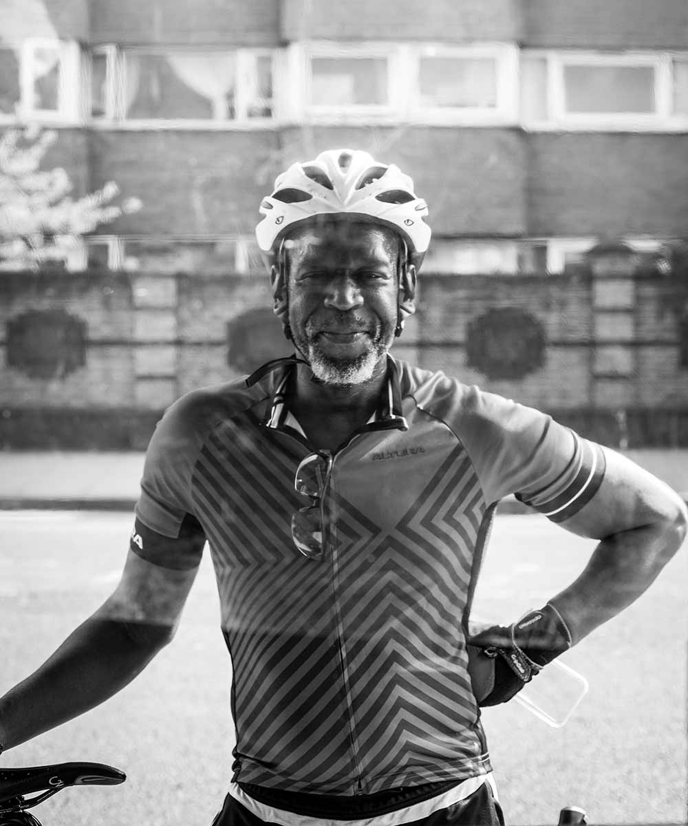 man in bicycle helmet outside Cafe Quarantacinque