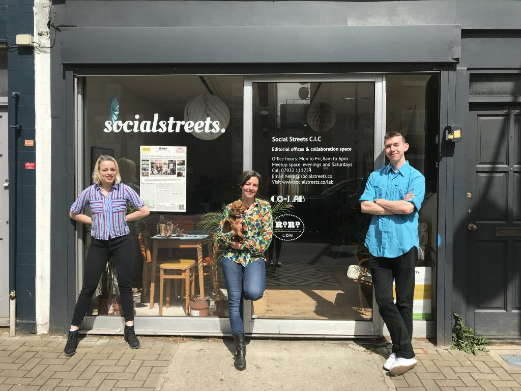 The editorial team of Roman Road LDN, outside their shop on Roman Road in 2019