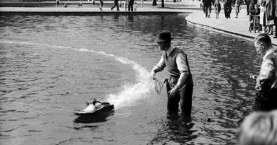 Man launching steam boat in Victoria Park lake
