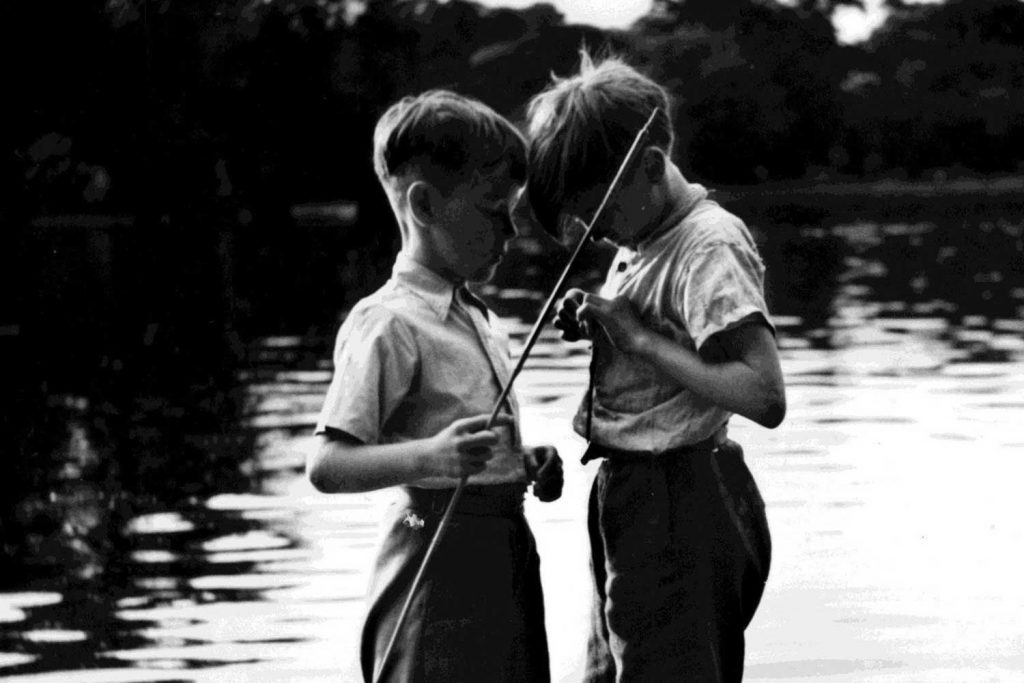 Children with fishing rod by Victoria Park lake