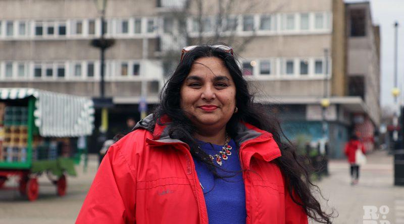 Julie Begum, of Swadhinata Trust, standing on Globe Town Market Square