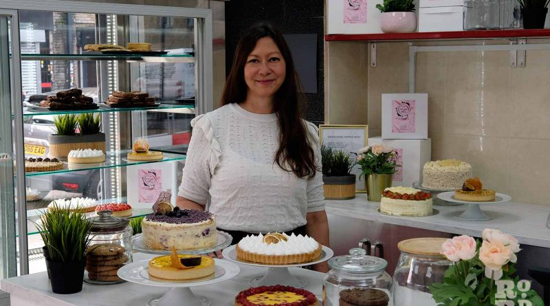 Pam Tironi, owner of the Bakery Room, Roman Road in East London, surrounding by cakes