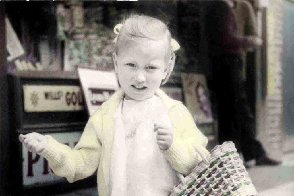 Young girl outside the sweetshop on Roman Road in the 1960s
