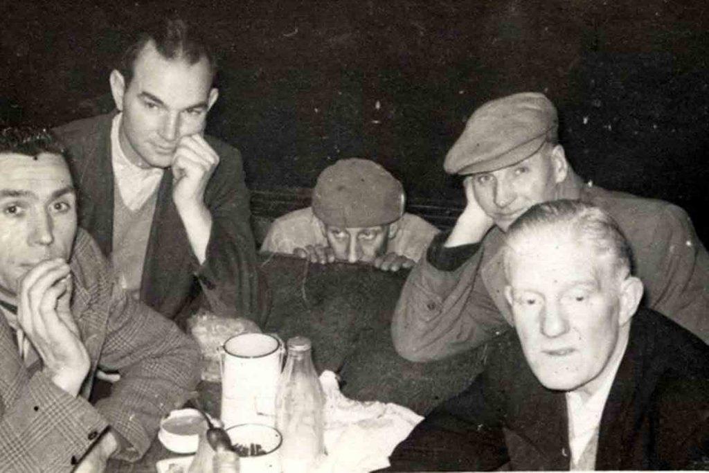 Linda's grandad at work - 5 men at a table