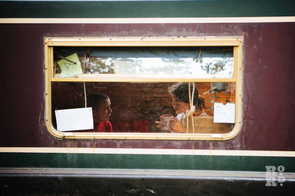 Enjoying a cup of tea - a window into canal boats on Regent's Canal, by photographer Rose Palmer