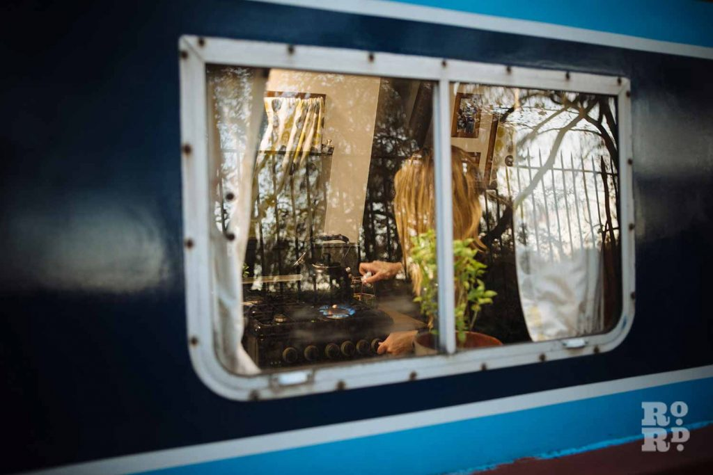 Cooking - a window into canal boats on Regent's Canal, by photographer Rose Palmer