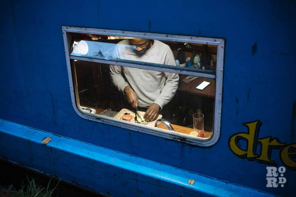 Preparing a meal - a window into canal boats on Regent's Canal, by photographer Rose Palmer