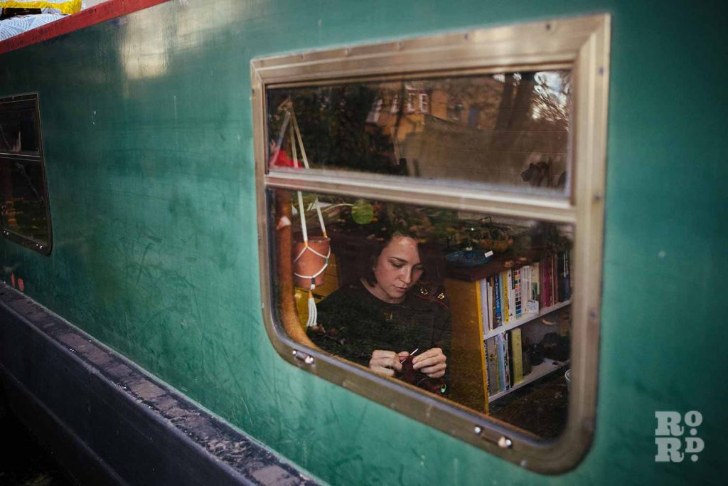 Knitting - a window into canal boats on Regent's Canal, by photographer Rose Palmer